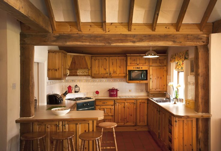 Fully fitted farmhouse pine kitchen (integrated electric oven and hob, microwave, refrigerator, freezer, dishwasher, washing machine, tumble dryer and breakfast bar).