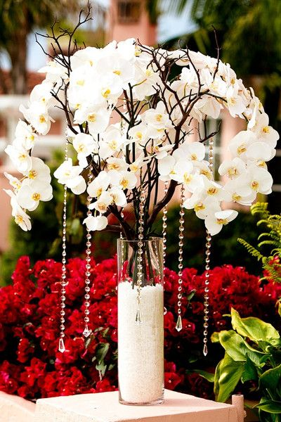 "RoseNerds.com Tall orchid centerpiece with crystals. Spray paint branches gold or silver to add more ""lustre"" 