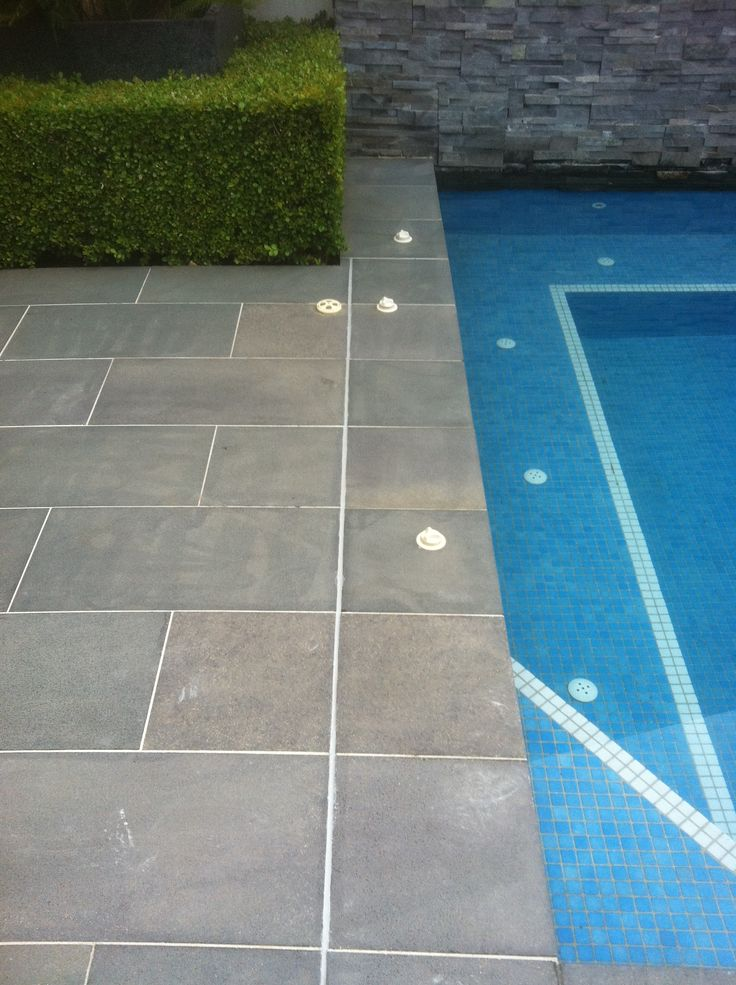 www.pavingcanberra.com Natural Stone Pavers, Pool Paving Repair, Paving on a concrete base, glued and grouted. Replaced expansion joint.