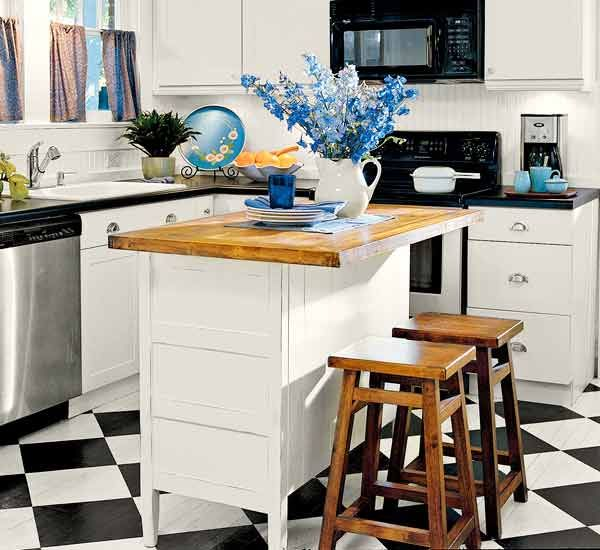 Create a kitchen island by fitting an old dresser or Hoosier cabinet base with a butcher-block top. Leave a 12-inch overhang on one side to create a breakfast bar. | Photo: Jean Allsopp | thisoldhouse.com