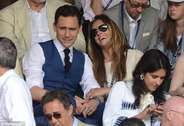 Love match? Tom Hiddleston at the Men's Singles Final on Sunday holding hands with rumoured girlfriend Jane Arthy