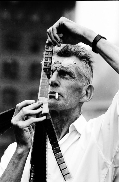 """Siobhán Bohnacker explores why Samuel Beckett was """"an especially appealing subject"""" for photographers: http://nyr.kr/1hw0ybl  """"Steve Schapiro shadowed Beckett during the production of the playwright's movie 'Film,' in 1964. Shapiro told me, 'Beckett seemed introspective and engrossed in his own world. Most of the time, I doubted that he was even aware I was there, and I am sure cared less.'""""  Beckett on the set of his movie """"Film,"""" 1964. Photograph by Steve Schapiro"""