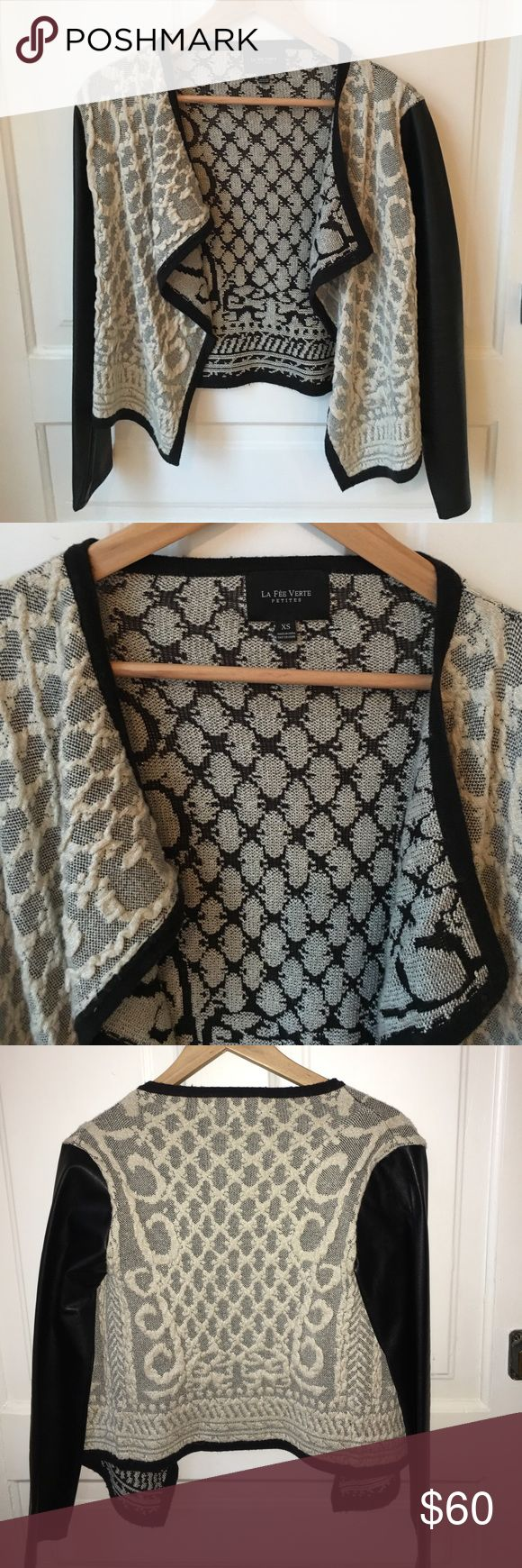 Open Front, Faux Leather Sleeve - Anthropologie Super chic black and silver cardigan from Anthropologie. Faux leather sleeve. Worn once, with notable impressions in the sleeve from where. Looks amazing with dresses or jeans. la fee verte Sweaters Cardigans