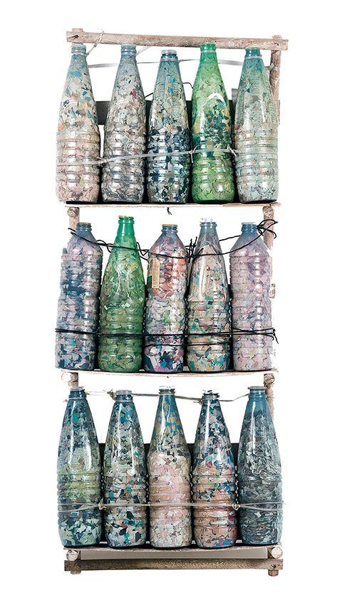 CONFETTI/ Arthur Bispo do Rosário, n.d., fifteen plastic bottles filled with colored confetti on a wooden structure, collection Museu Bispo do Rosário Arte Contemporânea, City Hall of Rio de Janeiro, Braz