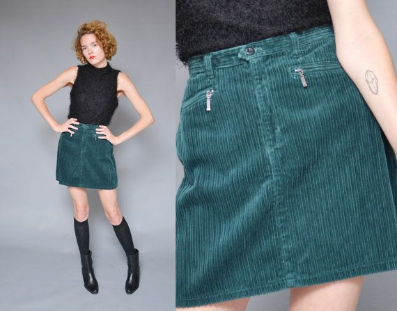 This is a darling 1990s does 70s corduroy mini skirt. Rich green skirt with ribbed texture, double zipper pockets, and full shape.  Palmettos Cotton Size 7 (Fits Small) Waist- 28 in Hips- 40 in Length- 17 in Excellent condition