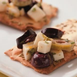 Marinated Olives & Feta | This easy Mediterranean snack is so delicious and ready in a jiff! It would even make an impressive appetizer.