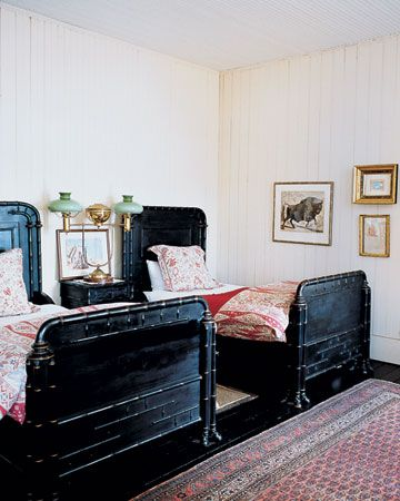 pretty bedroom...the black is interesting but adds warmth to the room...