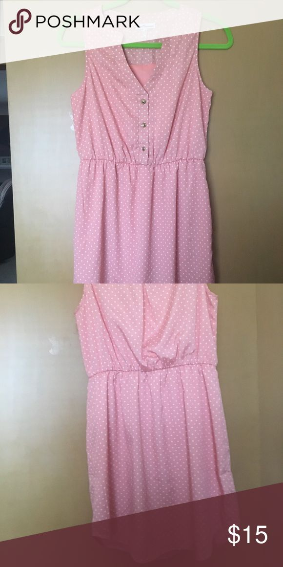 Light pink polka dot dress BNWOT Fully lined light pink mini dress, with gold button details. Brand New without tags. Elastic waist hits right at natural waist. Never worn Dainty Hooligan Dresses Mini