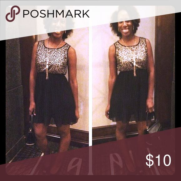 Black and Silver Dinner Date Dress It's got a pleated skirt bottom with a sequins top for an elegant look at a wedding or event dinner. Free necklace, pictured in photo! Pinky Dresses