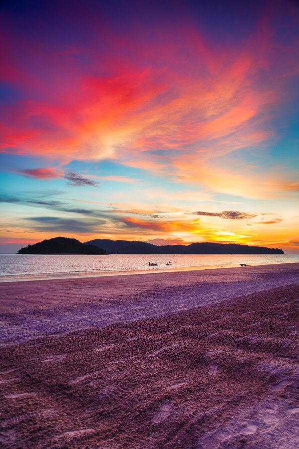 Sunset on Pantai Cenang at Pulau Langkawi in Malaysia.   Photo via 500px by Bruno Carlos.