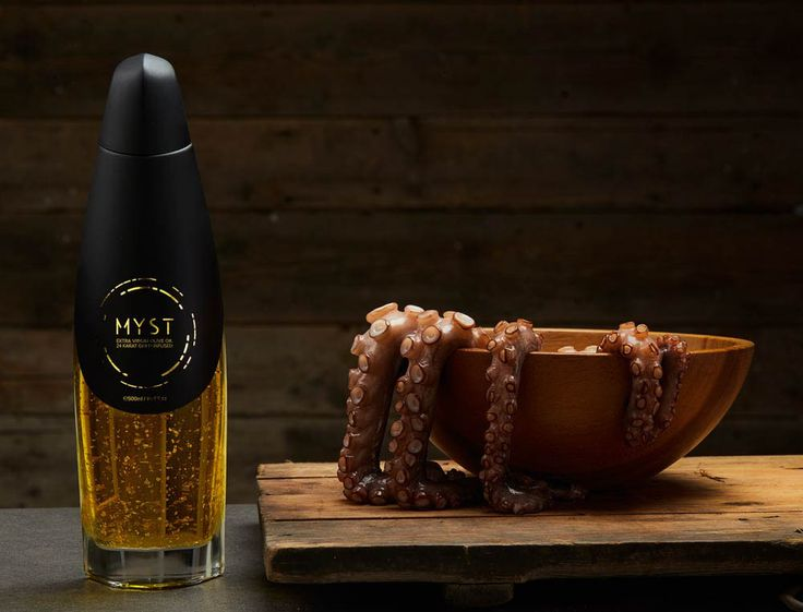 olive oil with 24 karat gold flakes. #oliveoil #olive oil #photography #graphic #luxury #foodstyling #styling #food #bootle