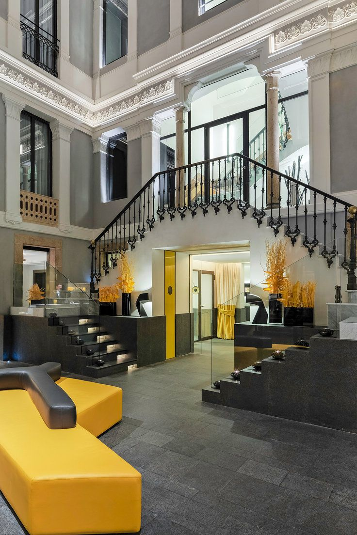 H10 Urquinaona Plaza - Barcelona, Spain - This sleek 80-room boutique blends original 19th-century features with bold pops of color.