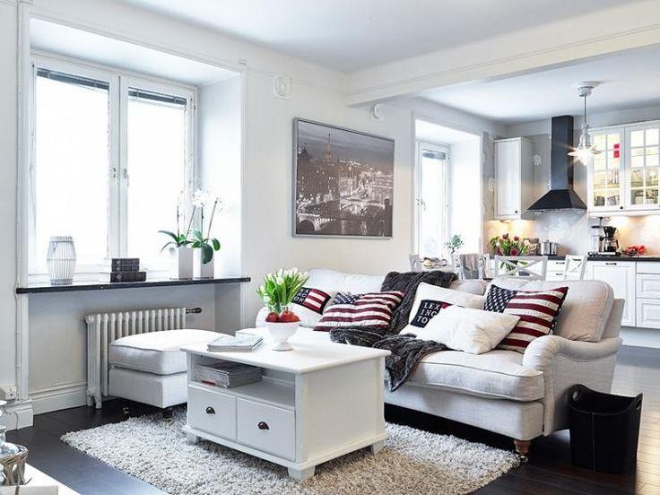 Зонирование помещения выполняется с помощью оригинальной потолочной конструкции