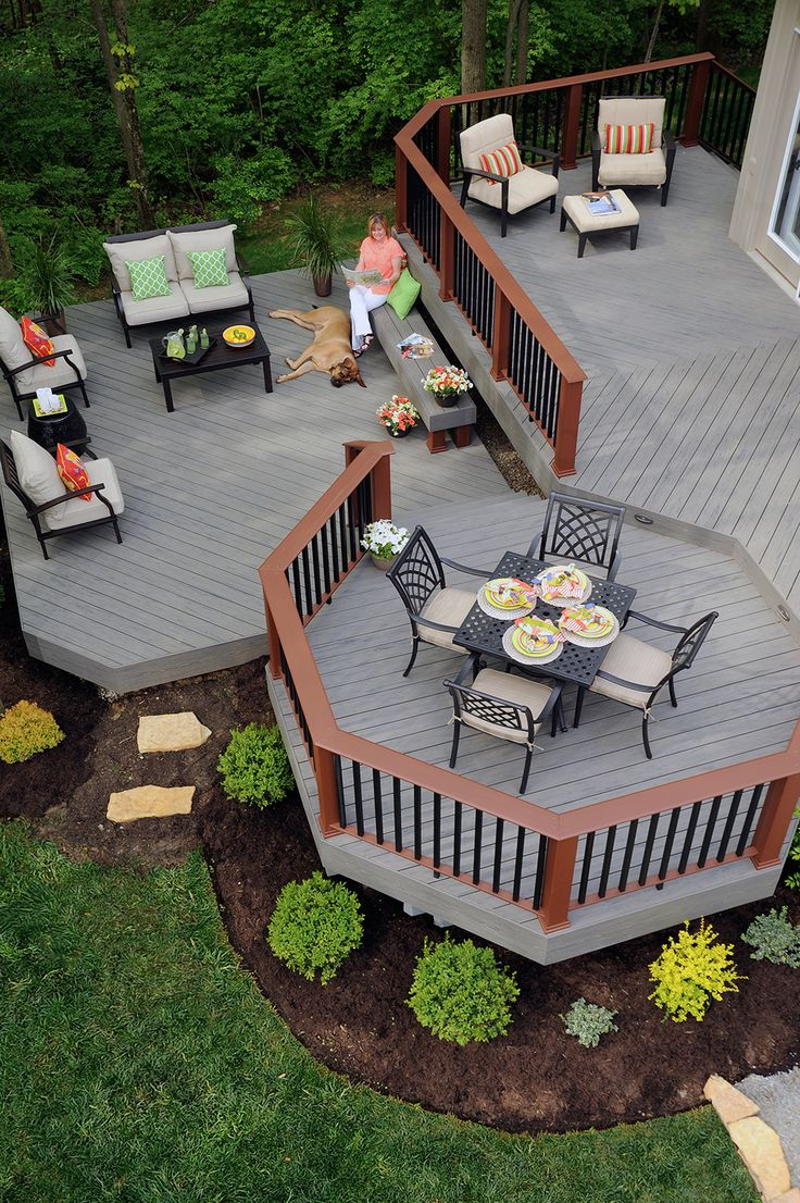 With the look and feel of wood, TimberTech decking in Silver Maple provides the ultimate outdoor living space. Paired with Evolutions Rail Contemporary in Brick and Black, this stunning deck will make every day a great one!