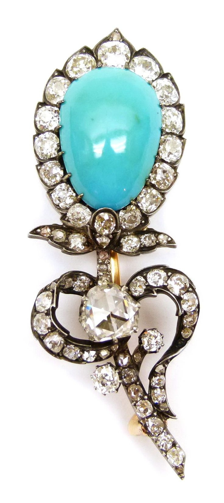 19th century turquoise and diamond cluster stylised flower brooch, French c.1840, an inverted pear shaped turquoise within a diamond border forming the principal flower bud, to a diamond set stem with curling foliage, a rose cut diamond and two smaller diamonds forming buds, open set in silver and gold