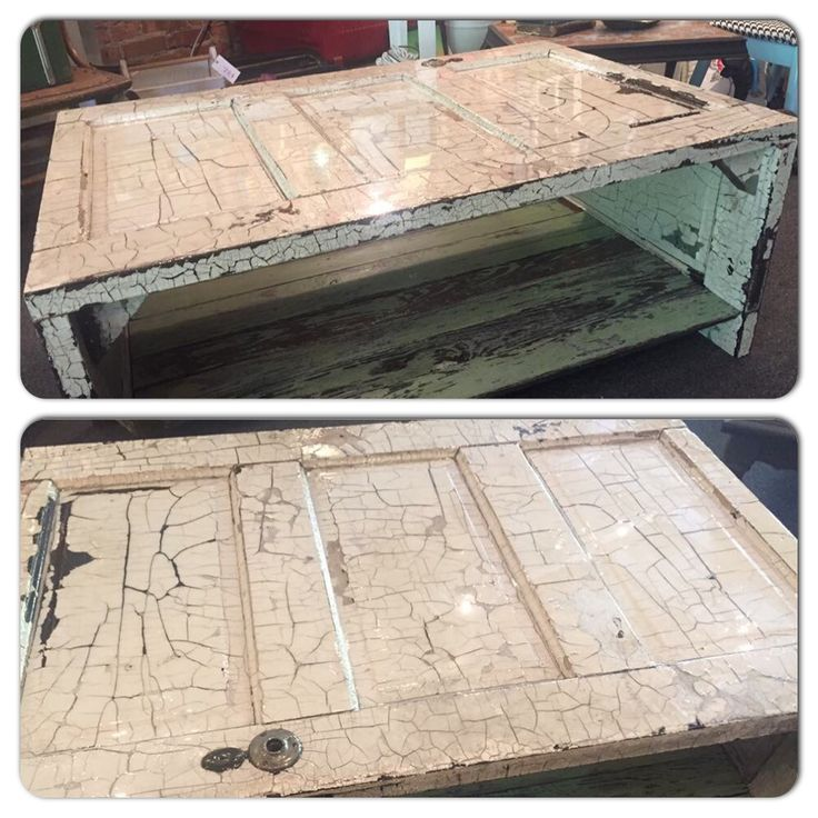 Old door new look. Coffee table made from an old 5 panel door and recycled bead board for the shelf