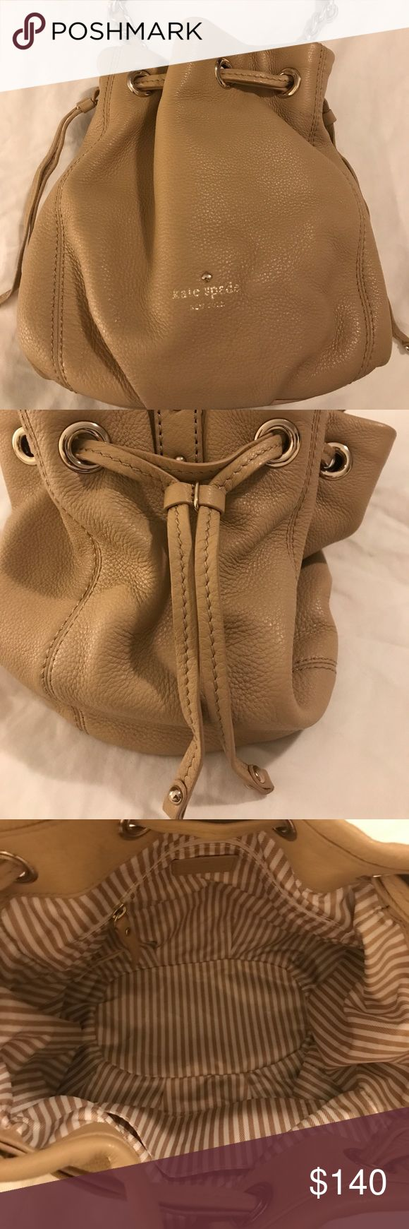NEW KATE SPADE COBBLEHILL KATIE BUCKET BAG!!! Very sharp beige slouchy leather shoulder bag with a rounded shape is cinched with double drawstrings and topped with a chain embellished strap in gold hardware.  Inside features a zippered pocket and a flap pocket. kate spade Bags Shoulder Bags