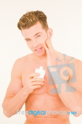 Man Applying Cream No matter where we are we live in the skin package given at birth. To protect is so important