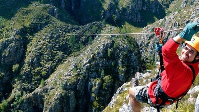 """The Cape Canopy Tour in the Hottentots Holland Nature Reserve recently opened hundreds of meters of ziplining – known as """"foefie-slides"""" in local vernacular – through majestic mountains near Grabouw. You'll slide on steel cables through this World Heritage Site and over valleys and waterfalls. Read more about things to do during #winter in #SouthAfrica on our website."""