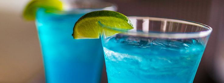 Carnival Blue Iguana Bar's Blue Margarita-- Blue's Blue Margarita    INGREDIENTS:  1.25 oz Margaritaville Tequila  0.75 oz Blue curacao  1.75 oz Frozen lemonade mix  1.75 oz Simple syrup    TO PREPARE:  Pour all ingredients in a blender  Add 1 large scoop of ice  Blend until smooth  Pour in a 12 oz glass    GARNISH:  Add lime