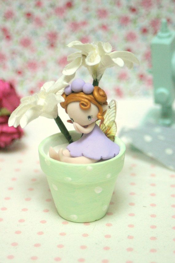 Fairy Figurine in a flower pot by TheDollAndThePea on Etsy