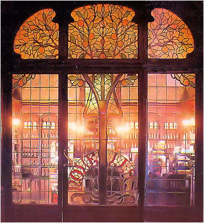 spectacular art nouveau pharmacy door in Barcelona Spain. Bottom middle section slides open