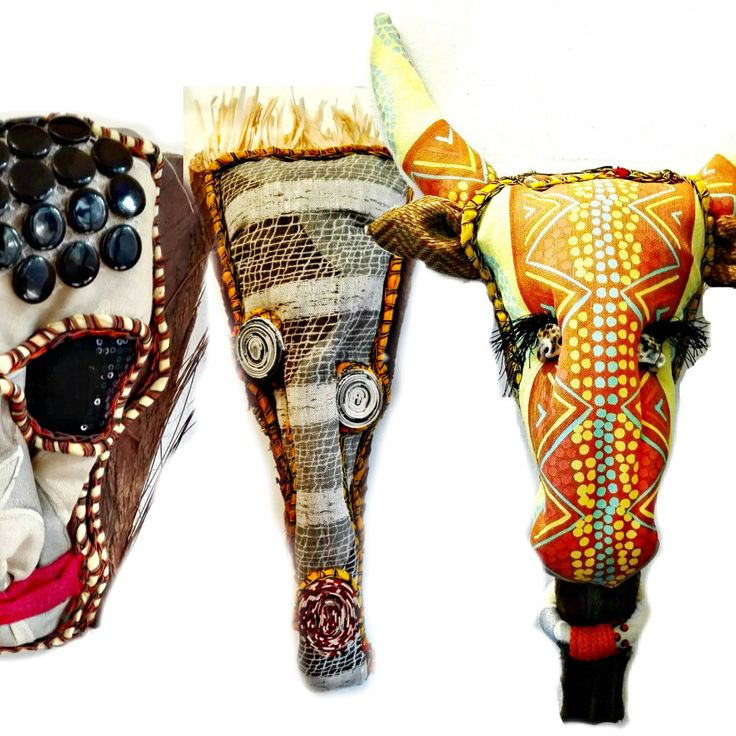 mask, totem and textile trophies mounted on palm leaves