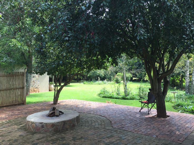 Treelands Estate Unit 5. Outside patio with fire lapa overlooking garden.