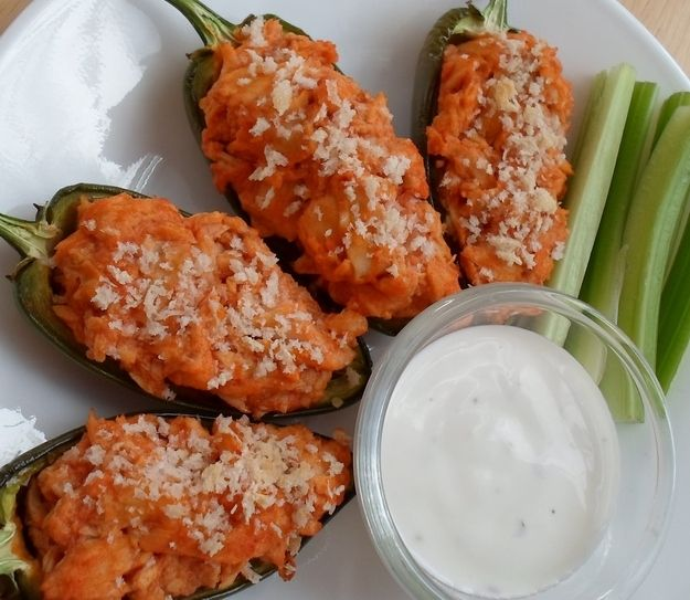With shredded chicken and wing sauce. | 31 Fearless Ways To Stuff A Jalapeño Chile