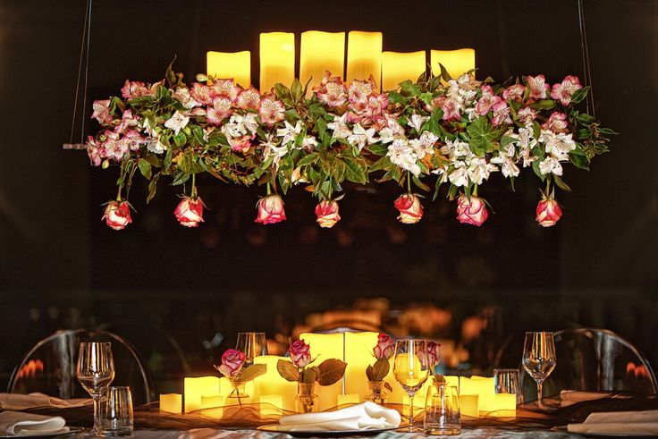 Creating a romantic wedding feast with rose-filled centre pieces.