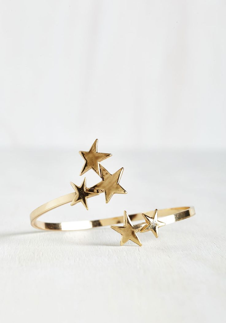 Pick Up the Space Bracelet. This celestial gold bracelet couldnt have come soon enough! #gold #modcloth