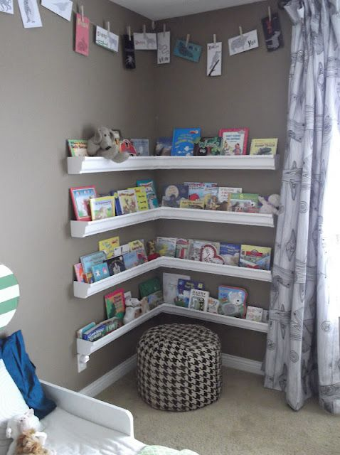 Vinyl rain gutters for book shelves. Such a cozy reading nook/corner. Easy for children to keep their special area tidy. Great idea!