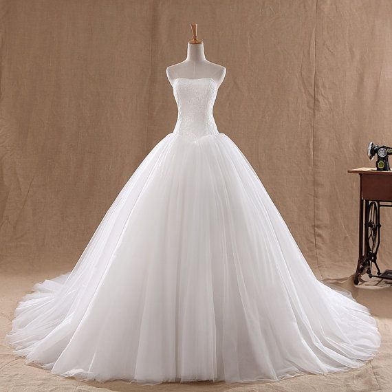 Princess ball gown    Strapless White/Ivory Tulle, Organza    Made to order.    Send your measurements as follows: -  1.Bust =___inches or
