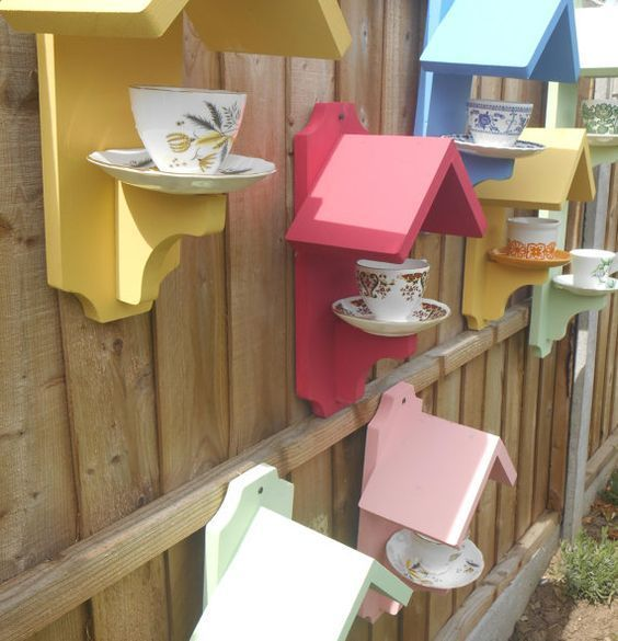 """This delightful bird feeder is made using painted pine wood and a vintage Teacup and Saucer. 15 x 8"""" approx PLEASE NOTE: These bird feeders…"""
