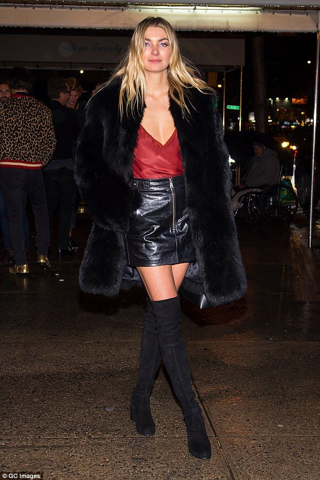 Turning heads! Victoria's Secret model Jess Hart stunned in a plunging red top and leather...