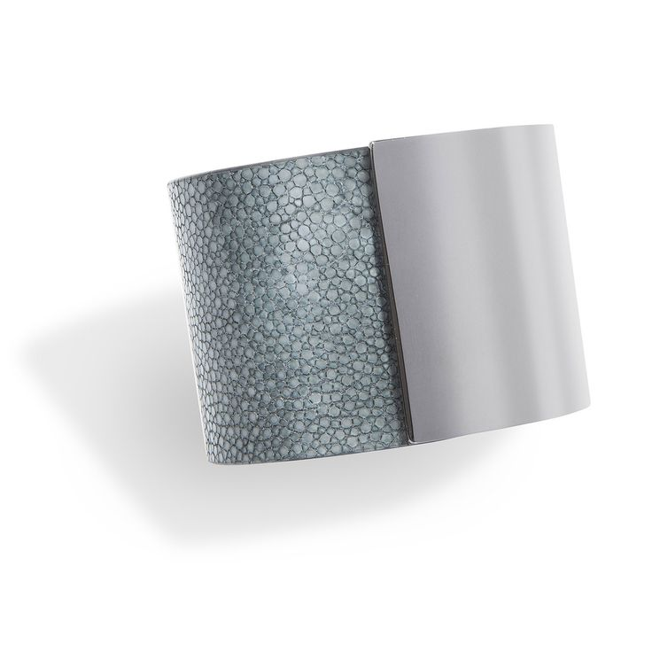 Momentum, a cuff bracelet in grey shagreen and titan-plated brass, hand crafted in a sleek and sophisticated design is the signature piece of De Galluchat. #treasurethemoment #momentum #cuff #shagreen #degalluchat #galuchat #titan