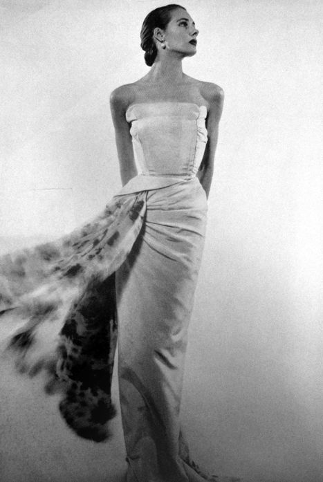Model wears an evening gown for Vogue Paris, 1951.
