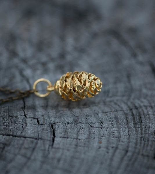 Gold-Dipped Pine Cone Necklace $28.00 Photography by @meganungerphotography This adorable Acorn Pendant symbolizes strength and power bestowing the wearer with unlimited possibility. Wear this darling piece when out on the town or out on a hike in the wilderness and luck will always be on your side.  Material: Real Pine Dipped in 24k Gold Chain Length: 74 cm
