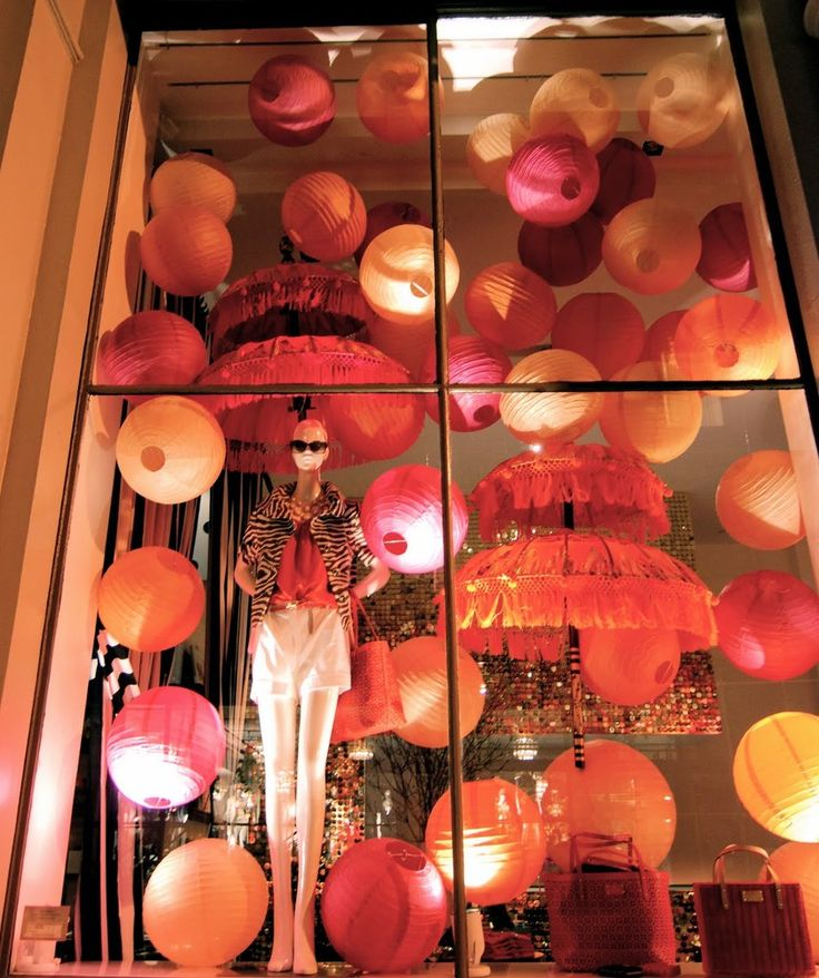 Paper lanterns can be used to decorate shop windows for a vibrant, unique display. At first glance they look like balloons but the lanterns offer a permanent feature.