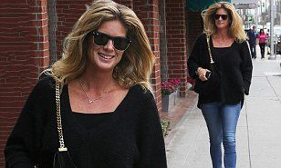 Rachel Hunter flaunted voluminous locks and trim pins as she stepped out in Los Angeles to run errands.