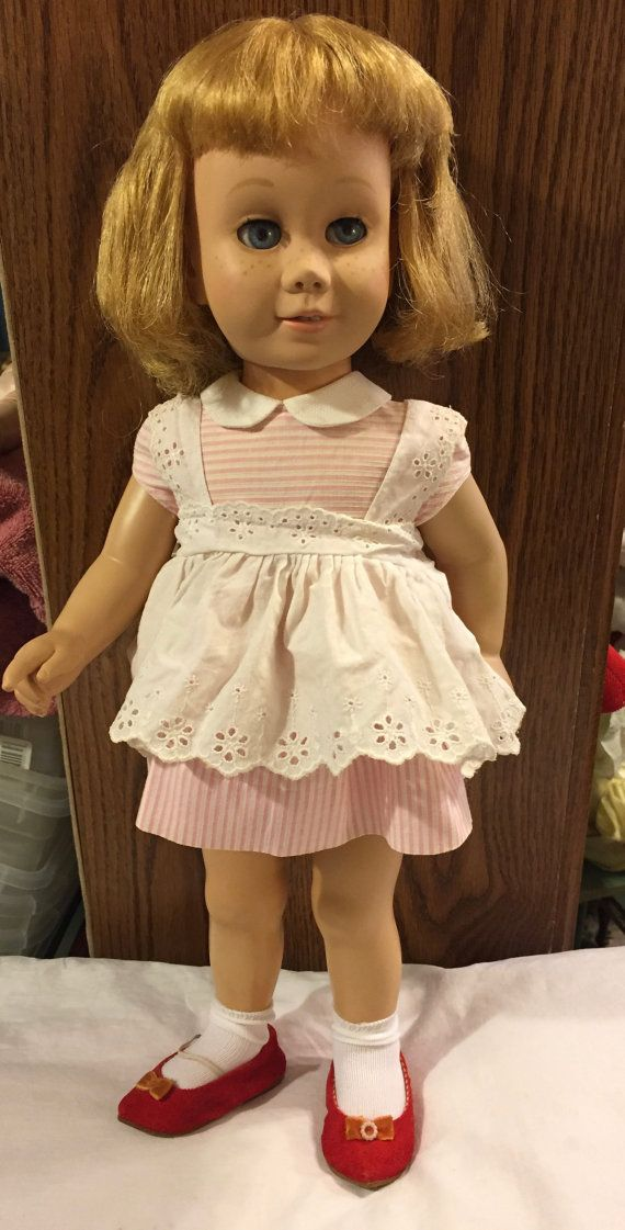 Vintage 1960s Chatty Cathy doll with an original dress/pinafore. Her red velvet shoes are original too but go with a different outfit. Her