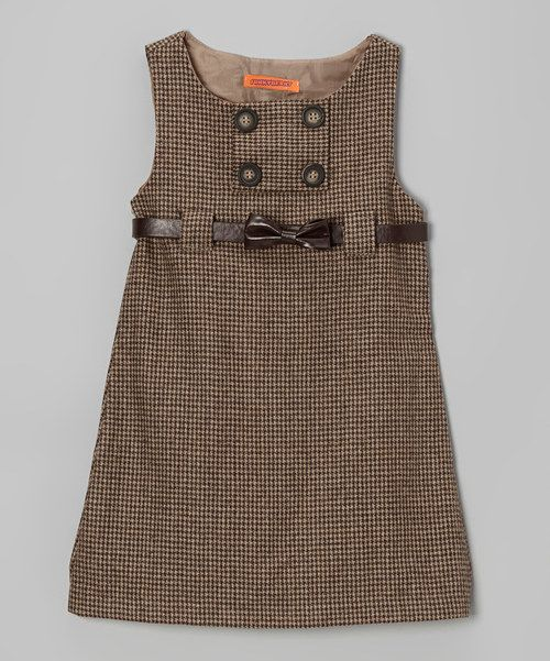 For the fashion-forward girl, this tweed dress boasts a stylish A-line silhouette with button detailing. Soft lining and an adjustable belt mean this fanciful frock is as comfy as it is charming.Includes dress and belt100% viscoseHand washImported