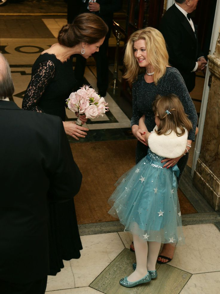 Catherine, Duchess of Cambridge meets Charlotte Tomlinson, aged 6, and her mother Cathryn at The Royal Variety Performance at the London Palladium on November 13, 2014 in London, England.