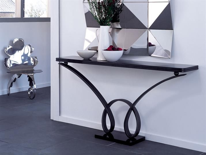 BYRON CONSOLE TABLE-DOUBLE LOOP Forged steel with pewter finish and black granite top and plinth, wall mounted. Dimensions: h890 w1750 d350 Finishes: Pewter, Antique Gold, Old Penny Bronze and Mirror Polished Stainless Steel