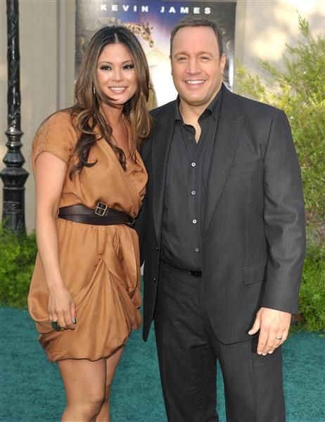 Interesting dress and belt situation. Kevin James and Steffiana de la CruzKevin James is a nice guy, but who knew he could land a hot model like Steffiana? The couple met on a blind date, and she moved in with him three months later. Way to go, Kev!