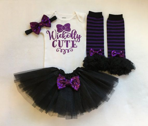 Baby girl halloween outfit. Please choose outfit options from drop down box. Current processing time is 5-7 business days. Purple non shed glitter wickedly cute bodysuit. Purple sequin bow attached to black elastic. Purple and black striped legwarmers with mini purple sequin bows attaches. Black tutu made of 3 layers of soft black tulle with purple sequin bow. Tutu is 7 inches long and best fits newborn-18 months.