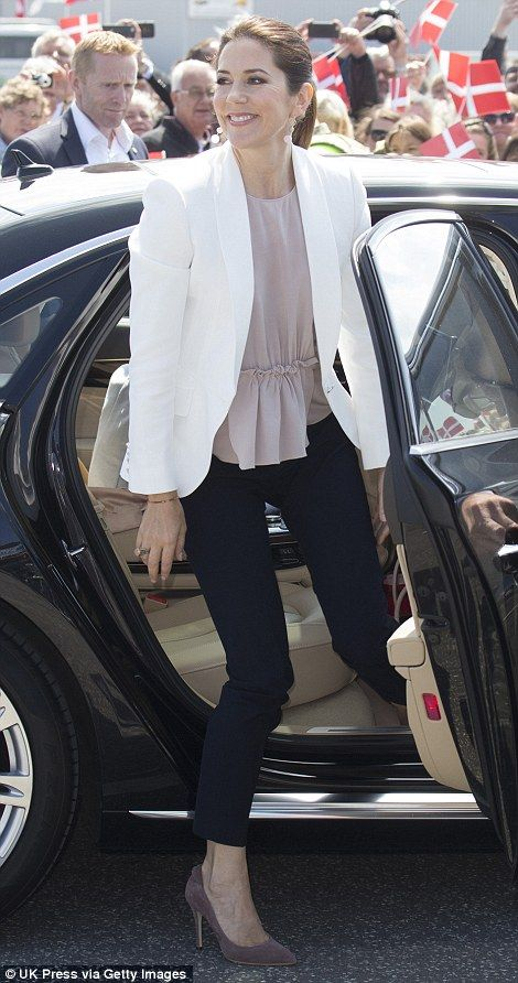 Mary paired tailored navy pants with a soft beige top and white blazer when she stepped out in Samso Island in June