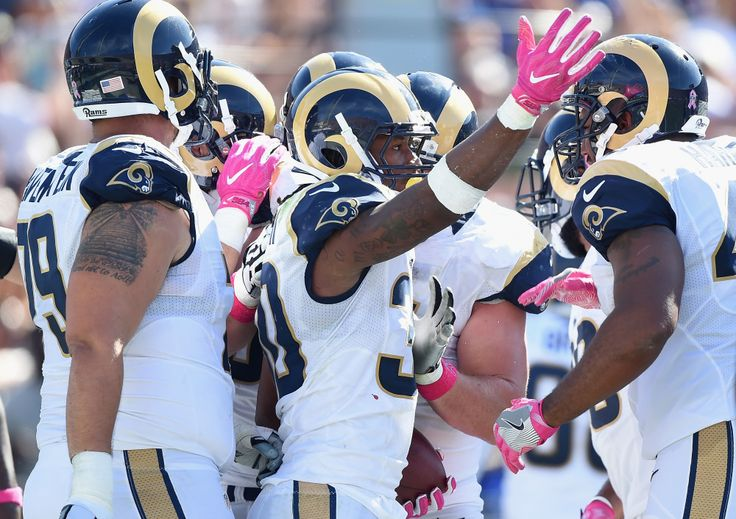 Todd Gurley #30 of the Los Angeles Rams celebrates his one-yard touchdown rush to tie the game 13-13 in the second quarter against the Buffalo Bills at the Los Angeles Memorial Coliseum on October 9, 2016 in Los Angeles, California. (Photo by Harry How/Getty Images)