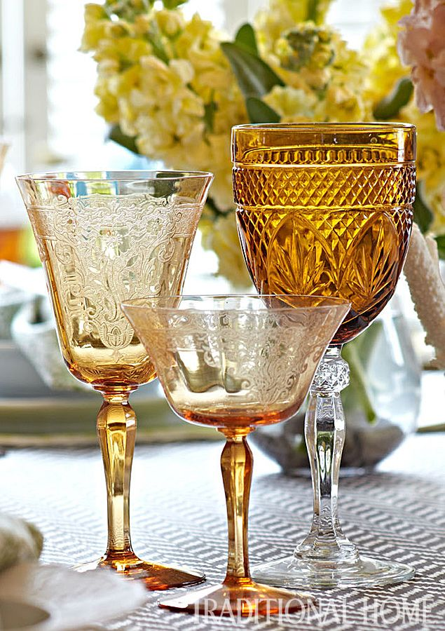 An amber water glass pairs with a delicately etched wine goblet and champagne coupe. - Photo: Peter Krumhardt
