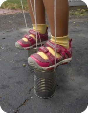 "Here's an example of ""blikje lopen"". Like walking on ""stilts"". We made them from empty soup cans, with thin rope attached on both sides of the cans. You could hear the cans from afar, as they made a ""klick-klack"" sound...so cool."